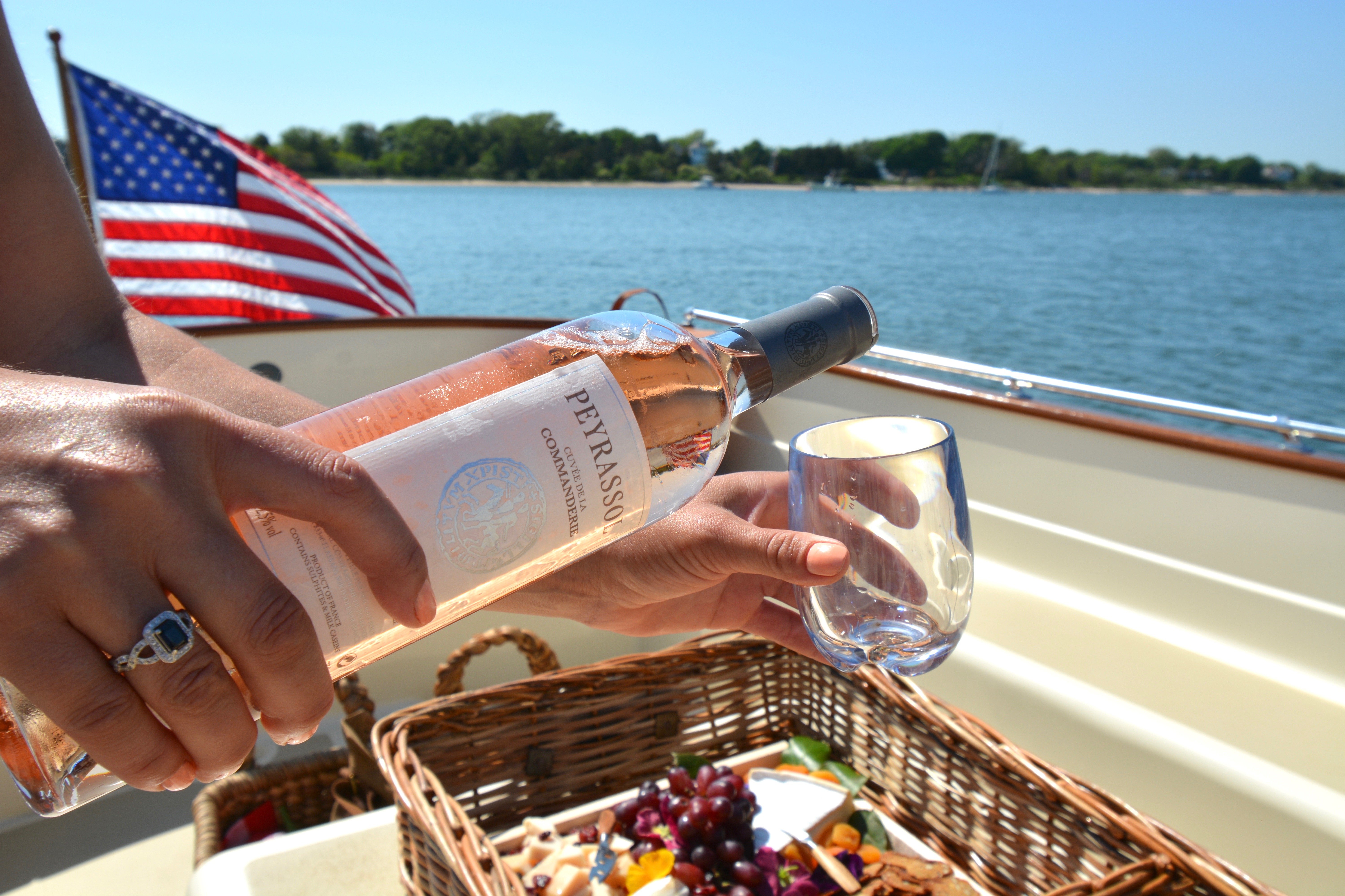 complementary rosé being served on Le Launch charter Siren.