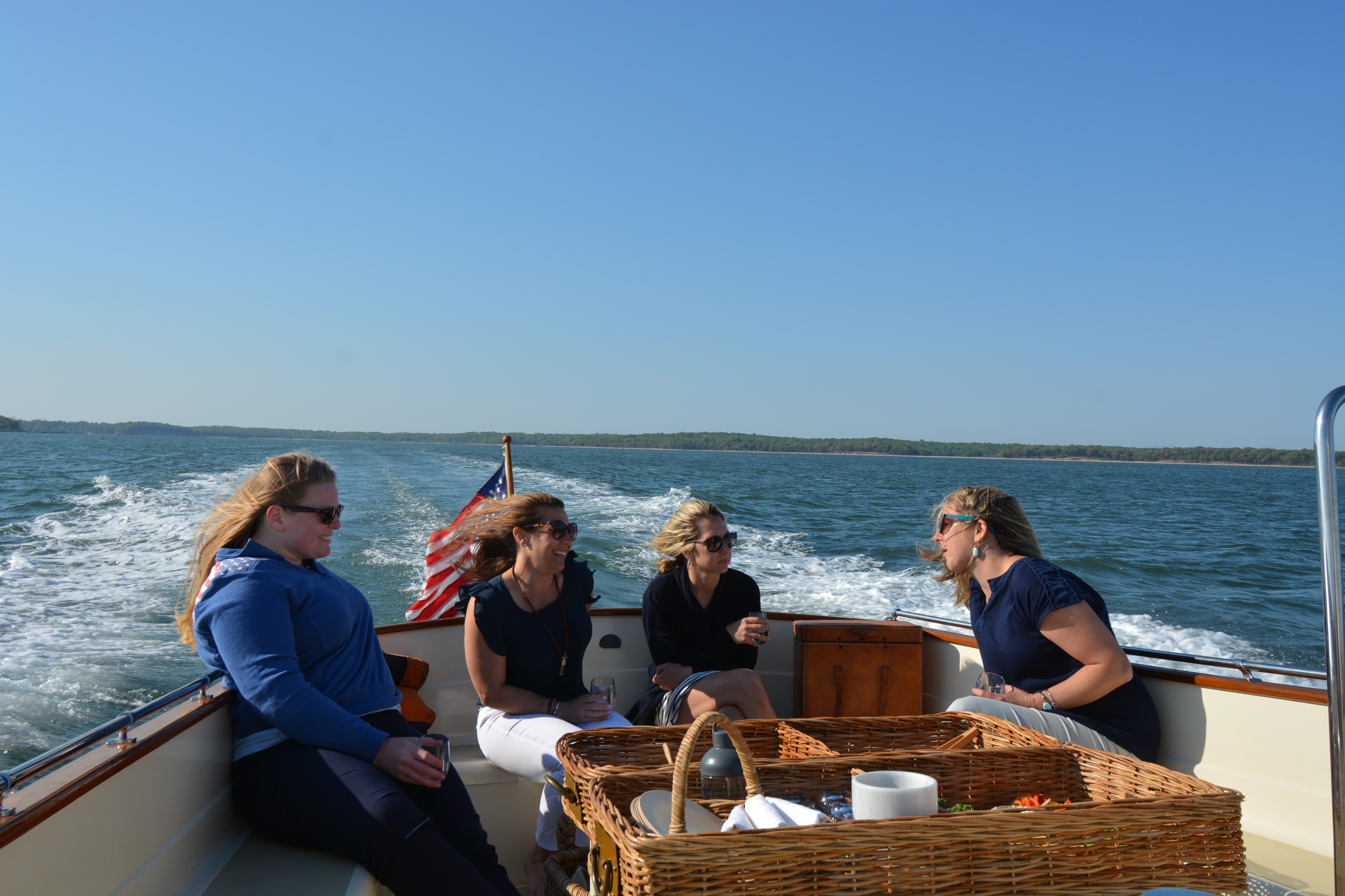 Group of women enjoying a private charter to and from waterfront restaurants located in the Hamptons.